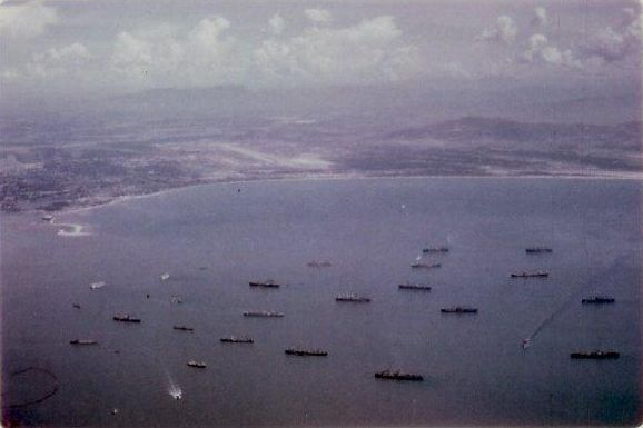 Ships in Da Nang harbor. Da Nang Main airfield in the background