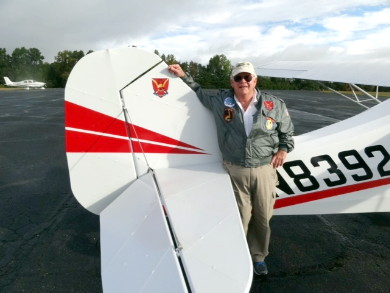 Doc Clement and his aircraft, N8392