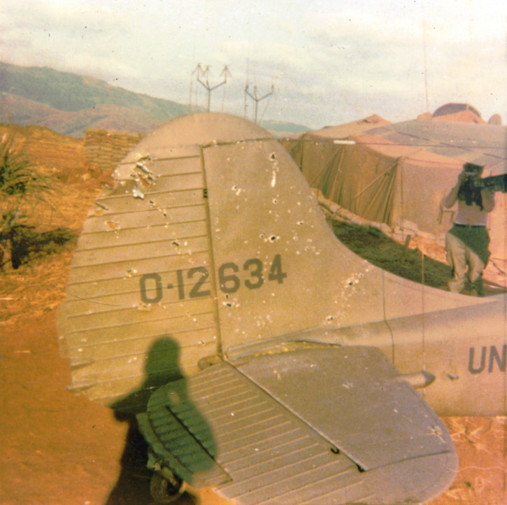 Catkiller Birddog damaged by 23 mm at Khe Sanh, 1971, photo by Tom Murray, Sundowner Mike