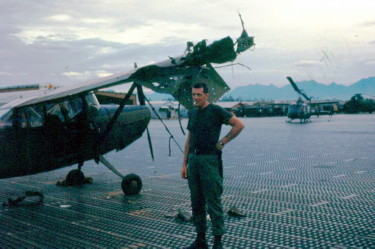 Roger Putnam at Marble Mountain airport, 1966, following a mortar attack
