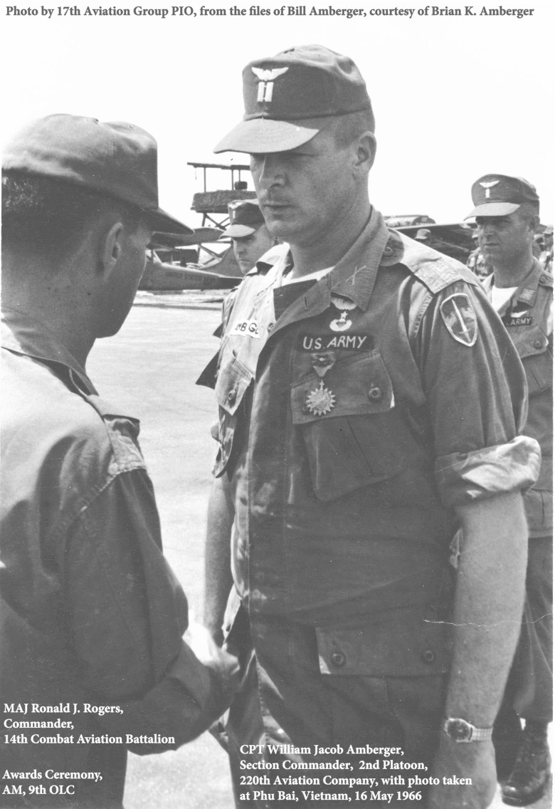 MAJ Ronald J. Rogers, Cdr, 14th CAB, awards the AM (9th OLC) to CPT William J. Amberger at Phu Bai, 13 May 1966