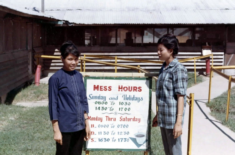 Catkiller Mess Hall and two Vietnamese employees