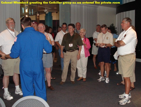 Colonel Doug Wheelock greeting Catkiller group